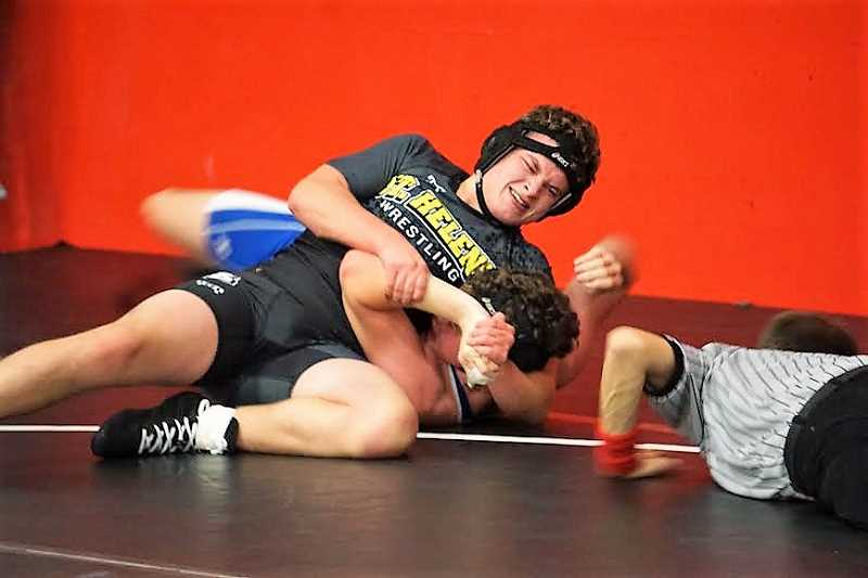 PHOTO CREDIT: AMY GADBOIS - Ryan Burri pinned Amity's Russell Brown for fifth at 170.