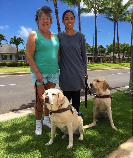 SUBMITTED PHOTO: YANA RAMOS - Yana Ramos poses with Vickie Kennedy and their guide dogs. Ramos was inspired to get a dog because of the relationship between Kennedy and her dog, Angela.