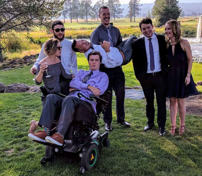PHOTO COURTESY OF THE AGAN FAMILY - Alex Agan is glad to be back with his friends. Here he is with Aubree Rasmussen, Brian Greenberg, Noah Estuesta, Max Jacobsen, Tyler Phelps, and Alysha Van Zante at his good friend Katy Wrights wedding.