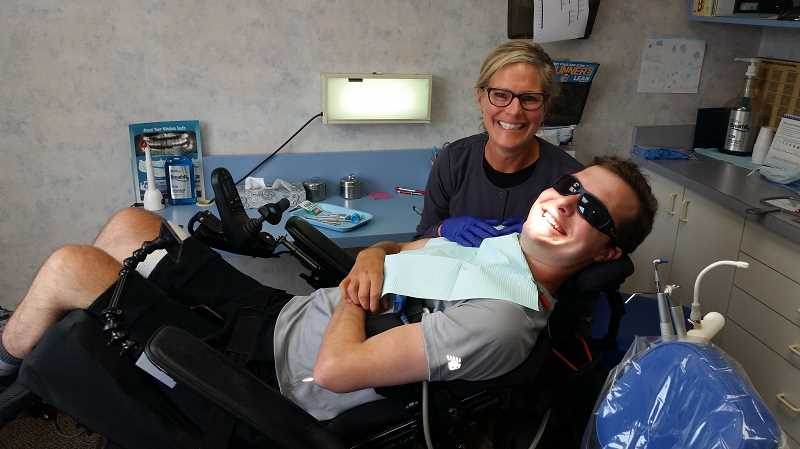 PHOTO COURTESY OF THE AGAN FAMILY - Alex Agan is doing normal activities again, like going to the dentist with Lori Dunham.