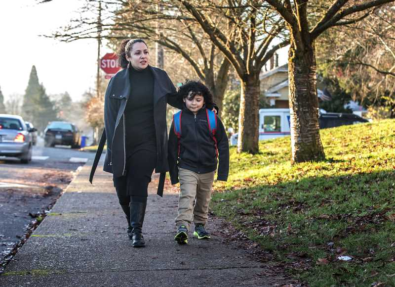 JONATHAN HOUSE/THE PORTLAND TRIBUNE - Katherine Rodela walks with her son Rudy at Oliver Lent Elementary School. She worries about the air quality near the school, due to its proximity to I-205.