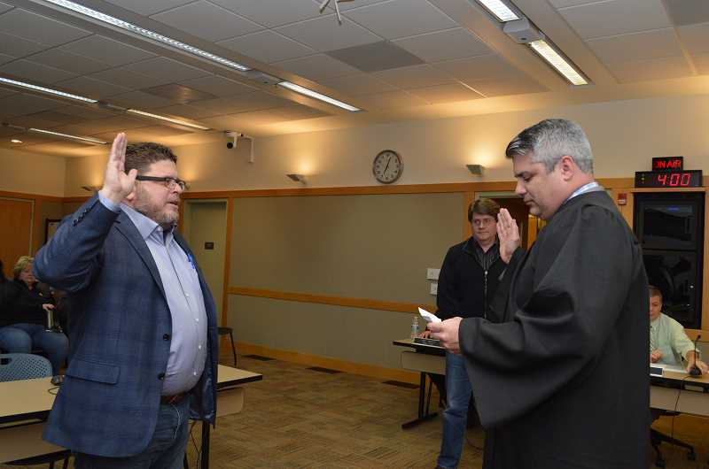 GAZETTE PHOTO: RAY PITZ - Tim Rosener is sworn in as a new member of the Sherwood City Council on Dec. 5 by Municipal Court Judge Brian Starns.