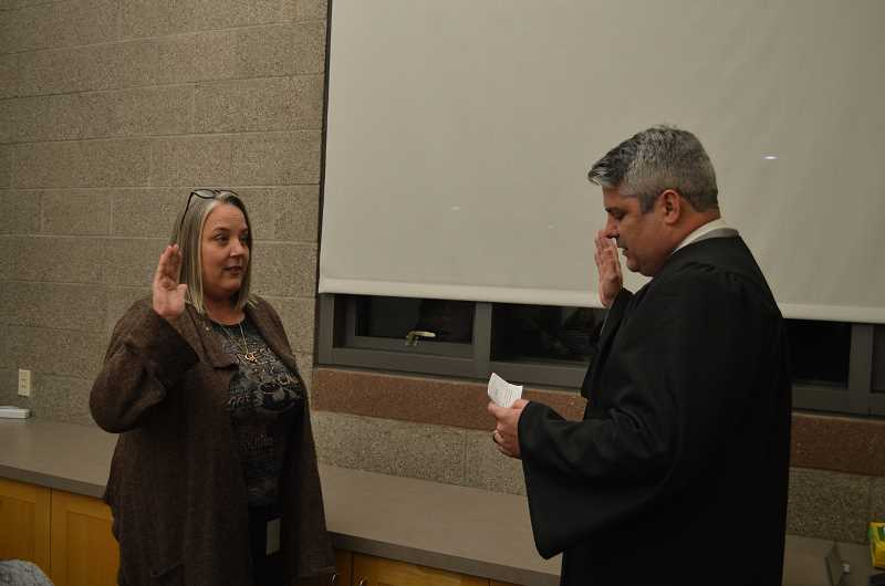 GAZETTE PHOTO: RAY PITZ - Councilor Renee Brouse, left, was sworn in as the newest member of Sherwood City Council on Dec. 4 by Municipal Court Judge Brian Starns.