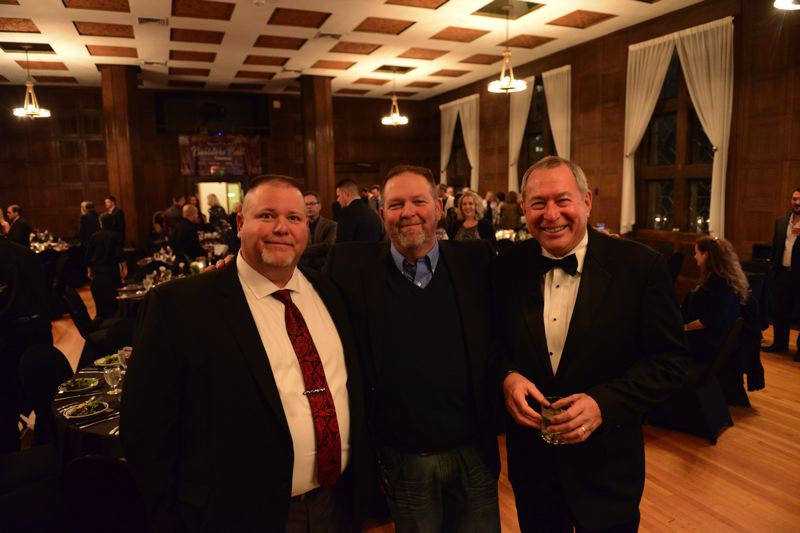ANDREW ROLES - Jason Behunin, his brother and Nate Bond at the 2017 Oregon Home Builders Association Builders Ball.
