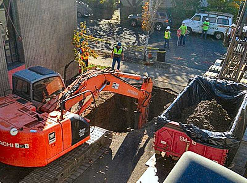 COURTESY BULLSEYE GLASS CO. - Workers employed by a certified remediation contractor dug out contaminated soil that surrounded a drywell at the Bullseye Glass Company.
