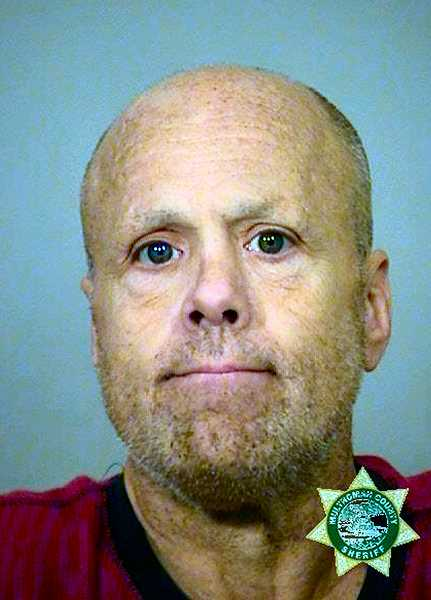 MCDC BOOKING PHOTO - Being held without bail, to face murder and other charges, is 54-year-old Shawn Kevin McGinnis.