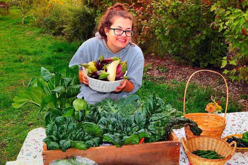 DAVID F. ASHTON - On the last day of the season of the Learning Gardens Laboratorys Farm Stand, Coordinator and Garden Educator Emma Pesis tempts buyers with the final produce of the season.