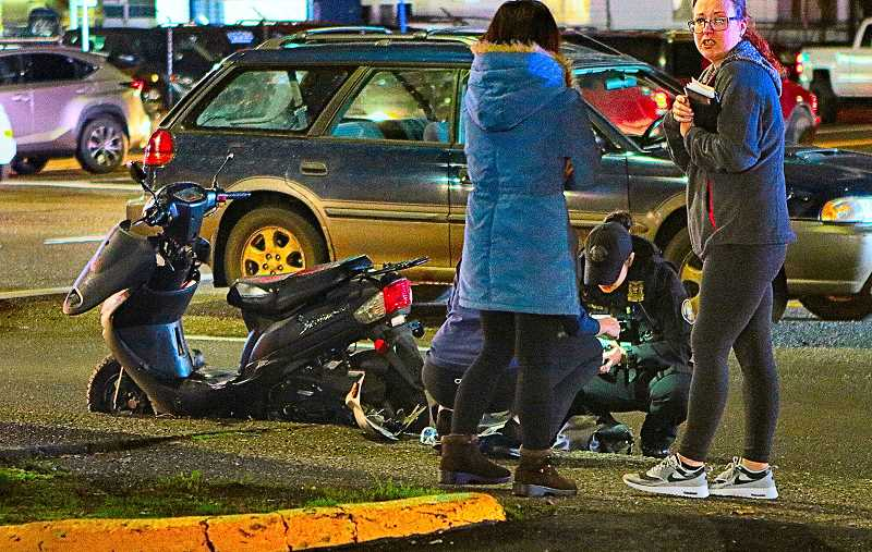 DAVID F. ASHTON - This busy Southeast Portland State Highway was closed while police investigated an accident between this motor scooter, propped up at the curb, and minivan.