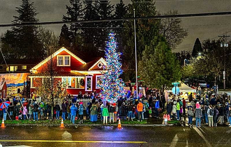 COURTESY OF GEORGE CROSLAND - The Woodstock Tree Lighting was captured from the rooftop of Ottos across the street, just after the lights were turned on.