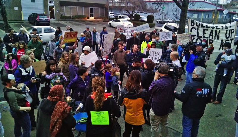 JIM REDDEN/PORTLAND TRIBUNE - Protestors demonstrate outside of Bullseye Glass Co. in Southeast Portland Feb. 17, 2016, calling for the Oregon Department of Environmental Quality to shut down the company's operations during an air pollution investigation.