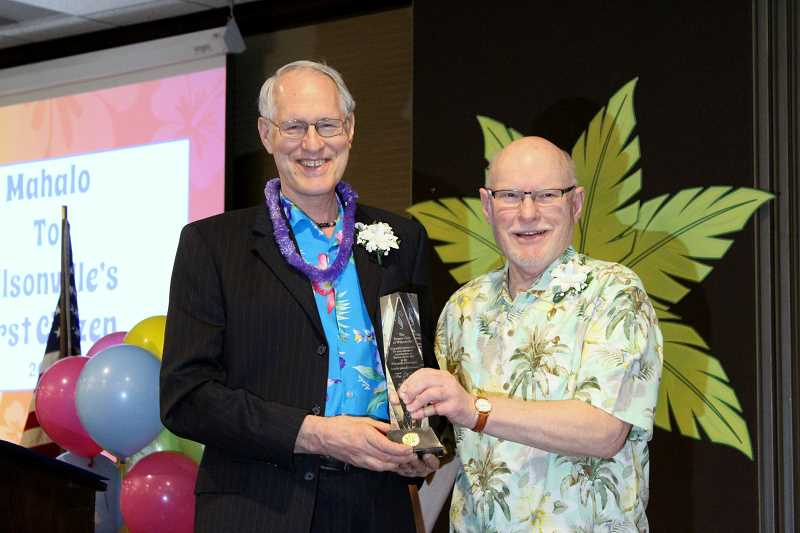 SPOKESMAN FILE PHOTO - Wilsonville Mayor Tim Knapp, left,  accepts his First Citizen award during the 2017 Heart of Gold celebration.