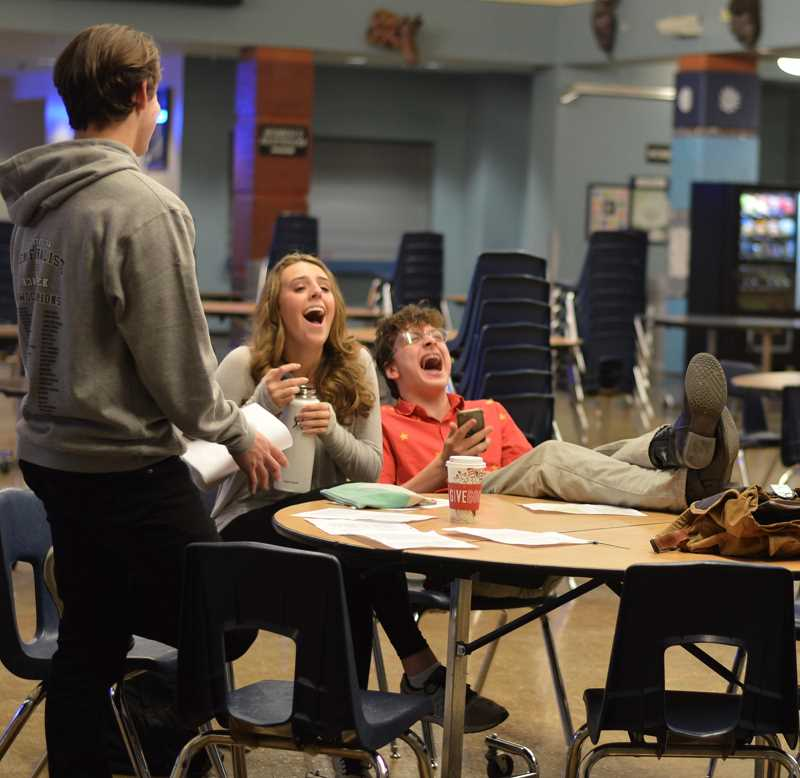 SPOKESMAN PHOTO: CLARA HOWELL - Sophomore Kameron Koslowski (right), and junior Tenley Lubisich enjoy the wit of Oscar Wilde during auditions for The Importance of Being Earnest.