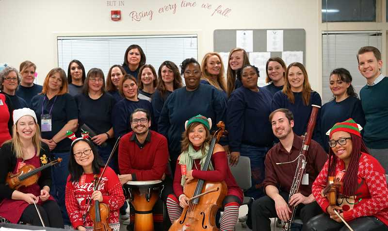 PHOTO COURTESY OREGON SYMPHONY - Oregon Symphony members with Coffee Creek Correction Facility Choir, performing at a Dec. 12 show in the prison.
