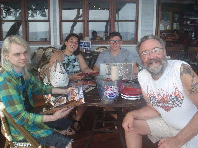 PHOTO COURTESY: KATHRYN EASTWOOD - Troy Eastwood (right) enjoys a meal in Hawaii on vacation with his sons, Sean and Garrett, and his son's girlfriend, Bella Begazo.