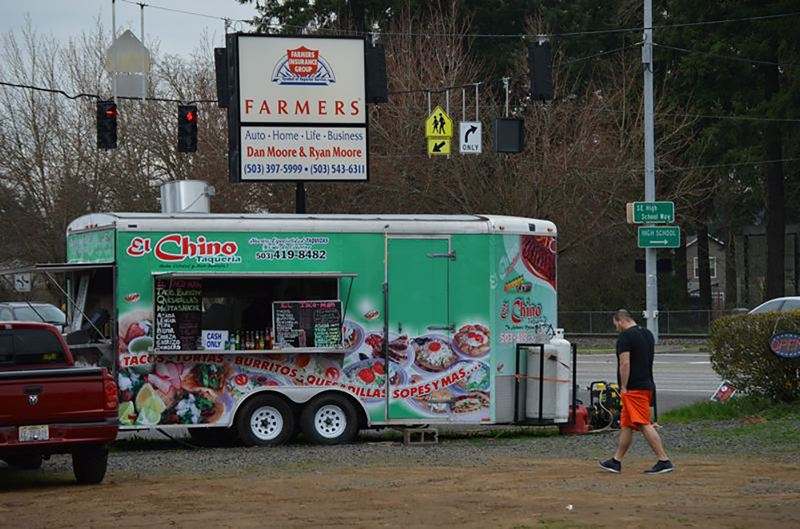 SPOTLIGHT FILE PHOTO - A food cart selling tacos on a commercial lot off Highway 30 in Scappoose was shut down in 2015 because the city didn't have any rules or codes to address mobile kitchens. Now, city leaders say carts could find a home in the city with the right planning and approval from the city council.