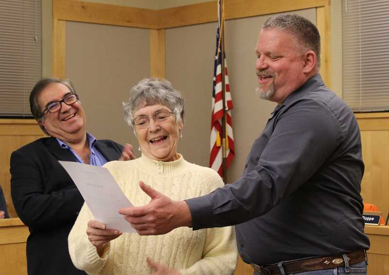 PHOTO CONTRIBUTED BY LISA MORGAN  - Enjoying a light moment during Tuesday's swearing-in ceremony for Dean Noyes, right, are Mayor Betty Roppe and City Manager Steve Forrester.