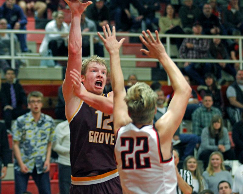NEWS-TIMES PHOTO: WADE EVANSON - The Forest Grove boys team (including senior post Sam Riley) and the Vikings will be back in action today when they host McKay in Greater Valley Conference action at 5:45 p.m.