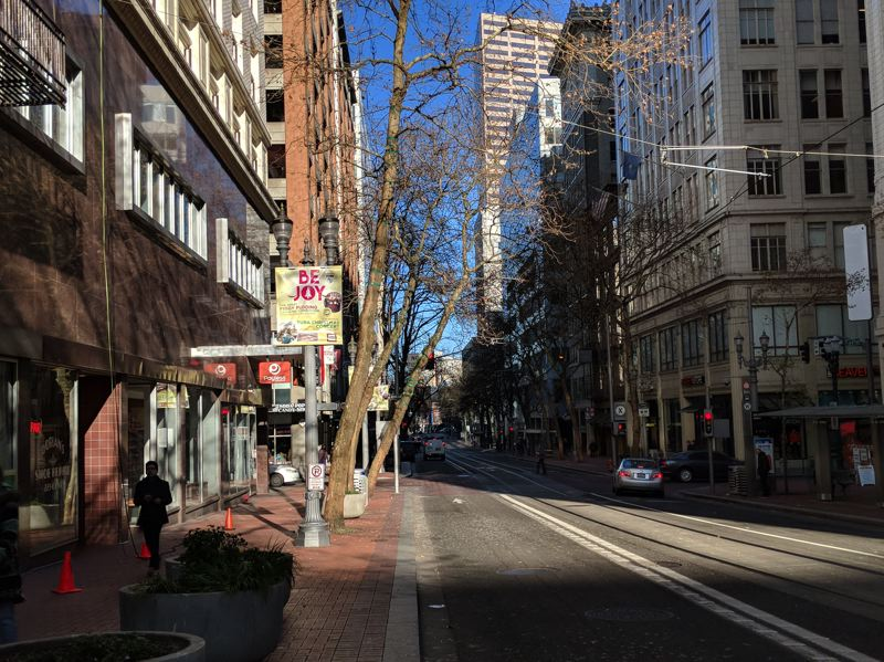 PAMPLIN MEDIA GROUP: JOSEPH GALLIVAN - Downtown Portland, Sixth Avenue looking north on a quiet Monday lunchtime. According to a survey by Downtown Clean and Safe, business owners feel safe, but think the city is dirty.
