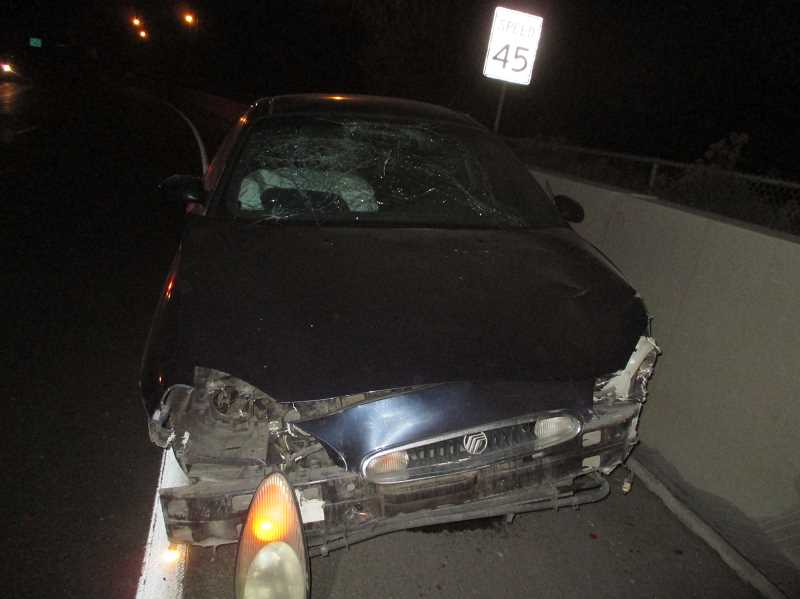 PRINEVILLE POLICE DEPARTMENT - Austin Owens crashed his car into the the cement barrier near O'Neil Highway Thursday night.