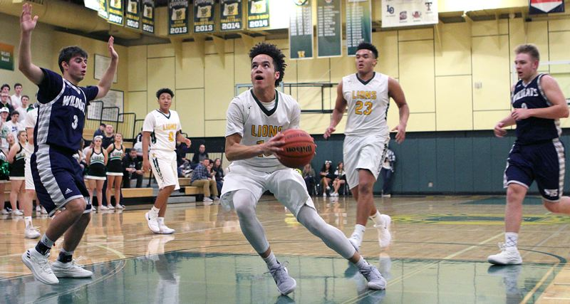 PAMPLIN MEDIA GROUP PHOTO: MILES VANCE - West Linn sophomore Bryson Crockett gets ready to score two of his nine third-quarter points during the Lions' 64-51 home win over Wilsonville on Friday.