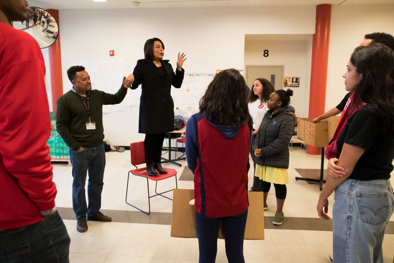 TRIBUNE PHOTO: JAIME VALDEZ - Multnomah County Commissioner Loretta Smith gives words of encouragement to students during Lincoln High School's annual food drive.