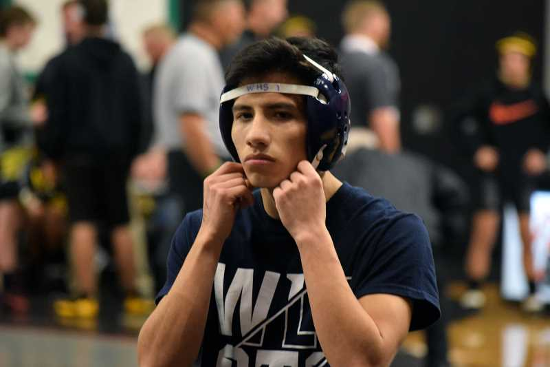 SPOKESMAN PHOTO: TANNER RUSS - Adzel Villanueva won four out of his five matches at the Liberty High School tournament on Dec. 16.