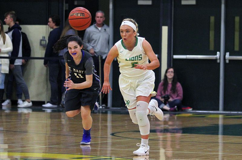TIDINGS PHOTO: MILES VANCE - West Linn senior guard Brooke Landis chases down a pass during her team's 74-40 win over St. Mary's at West Linn High School on Friday.