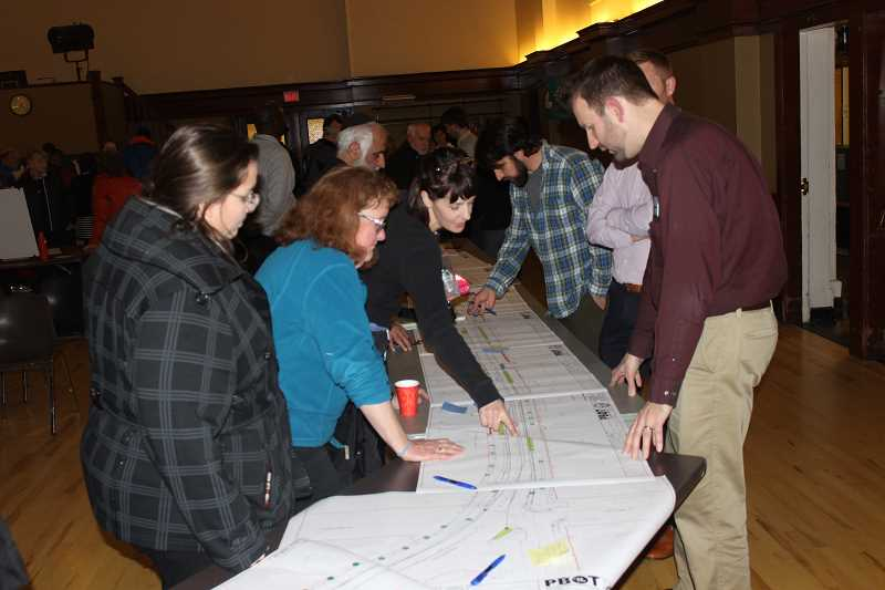 CONNECTION PHOTO: COREY BUCHANAN - Project Manager Steve Szigethy (right) answers questions about the City of Portland's Capitol Highway Project plan.