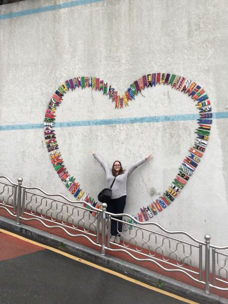 PHOTO BY LISA CLEMENS - Near Busan, Saira Bradner found a picturesque spot decorated with little fish painted by local schoolchildren and arranged in the shape of a heart.