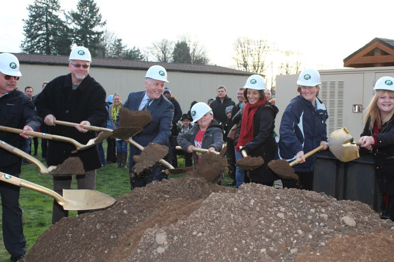 PHOTO BY: MADISON DALLING-RAISNER - North Clackamas Superintendent Matt Utterback and Lot Whitcomb Elementary student Tyson Shamp are flanked by school board members in breaking ground on bond construction.