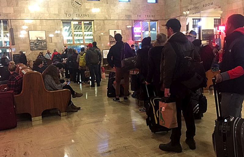 PAMPLIN MEDIA GROUP: JOHN SCHRAG - Passeners lined up Monday afternoon at Portland's Union Station, hours after an Amtrak Cascades train derailed near DuPont, Washington.