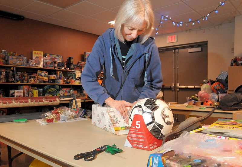 GARY ALLEN - Sharon Duble has volunteered to wrap presents for Toy and Joy for more than 10 years. Her husband Joe is a career firefighter in Newberg.