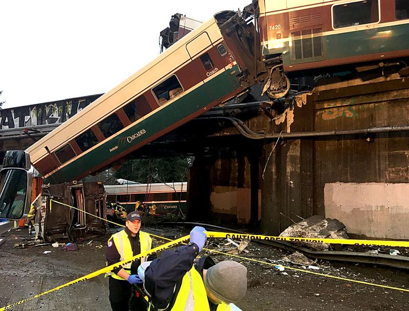 COURTESY PHOTO: WASHINGTON STATE PATROL - An Amtrak Cascades 501 train that derailed Monday morning near DuPont, Washington, may have been going faster than the track speed limit.