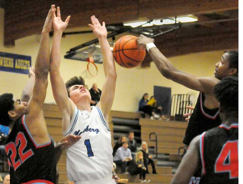 GARY ALLEN - Sophomore guard Jack Chlumak loses the ball in the lane during Newberg's 56-39 home loss to Madison Dec. 12.