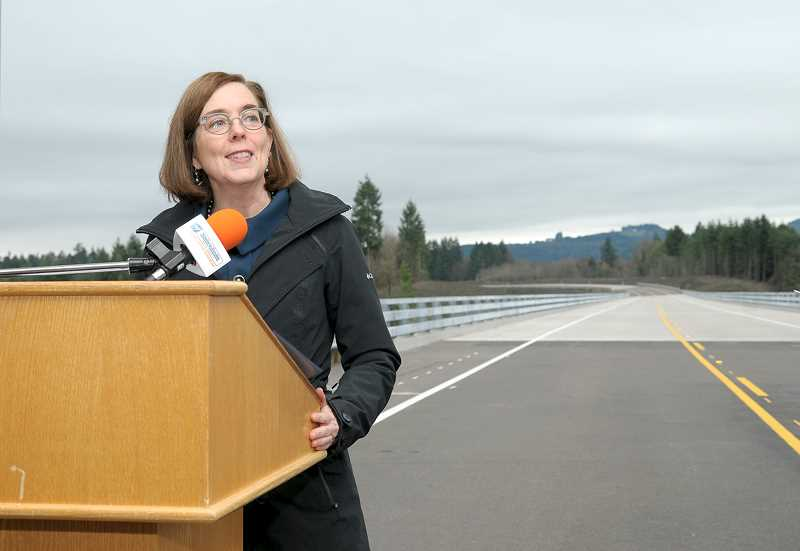 GARY ALLEN - Gov. Kate Brown speaks during a ribbon-cutting ceremony Monday afternoon at the halfway point of the Newberg-Dundee bypass.