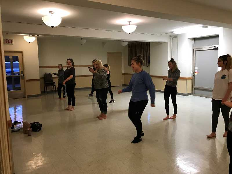 Kathleen Van De Veere, center, teaches dancers the routine they will perform at the nationally-televised Orange Bowl halftime show Dec. 30.