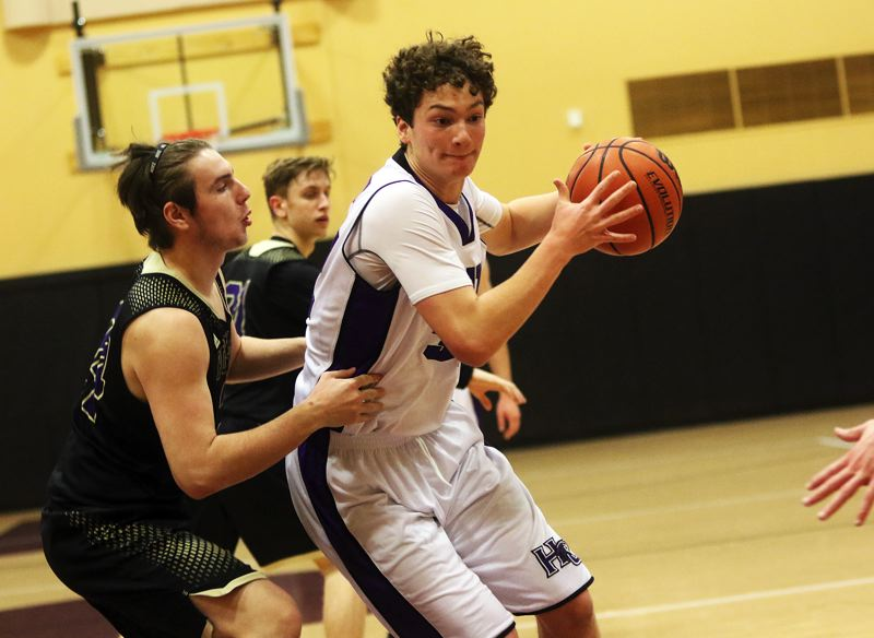 DAN BROOD - Horizon Christian junior Will Shelby looks to get to the basket during Tuesday's game.