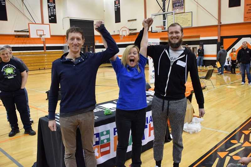 COURTESY PHOTO: PERENNIAL MATH - Math coaches Myron Peto (left) and Andrey Chernishov (right) came out with their own win at the tournament in one of the friendly parent competitions.
