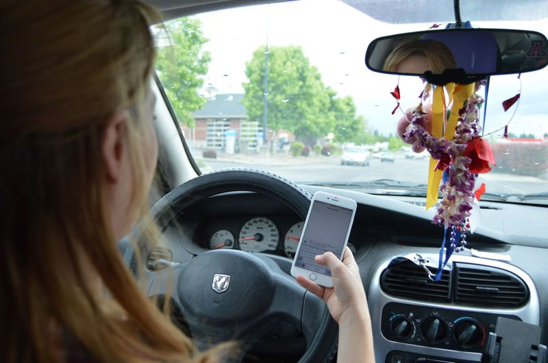 NICOLE THILL/SOUTH COUNTY SPOTLIGHT - Motorists can be fined up to $1,000 for their first offense under Oregon's new distracted driving law.