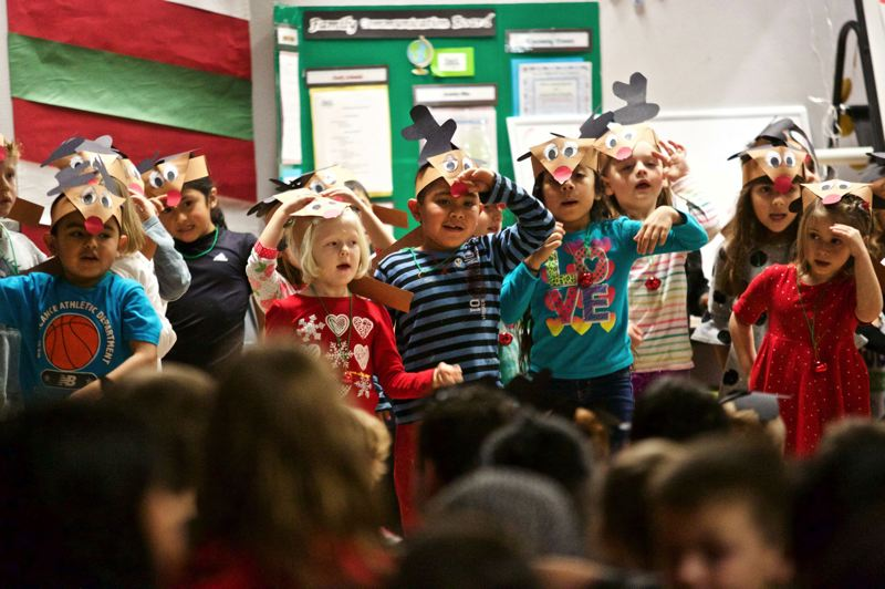 MARK MILLER/THE TIMES - Kindergartners sing and dance at Bridgeport Elementary School in Tualatin Dec. 21, 2015.