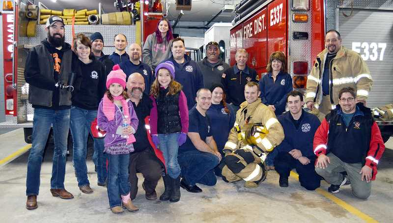 PIONEER PHOTO: CINDY FAMA - Colton volunteers (and family members) of Colton Fire gather for a photo op after the food drive Dec. 21.