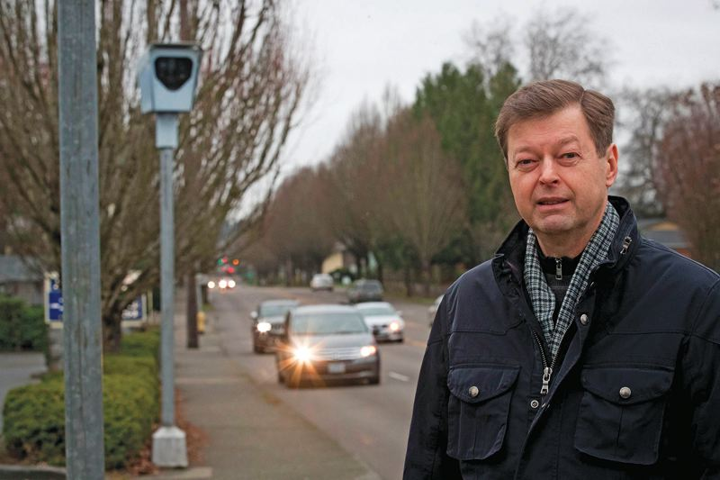 PORTLAND TRIBUNE: JAIME VALDEZ - Mats Jarlstrom has studied the red light cameras on the corner of Southwest Allen Boulevard and Lombard Avenue with testing equipment in his car.