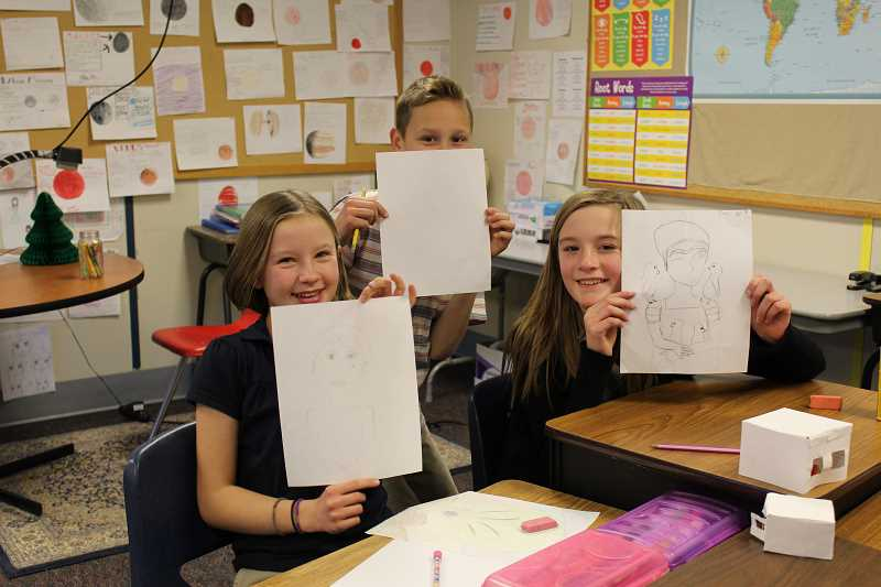 PIONEER PHOTO: KRISTEN WOHLERS - Students in Jessica Tosti's sixth grade class work on their sketches during an art lesson on Dec. 7.