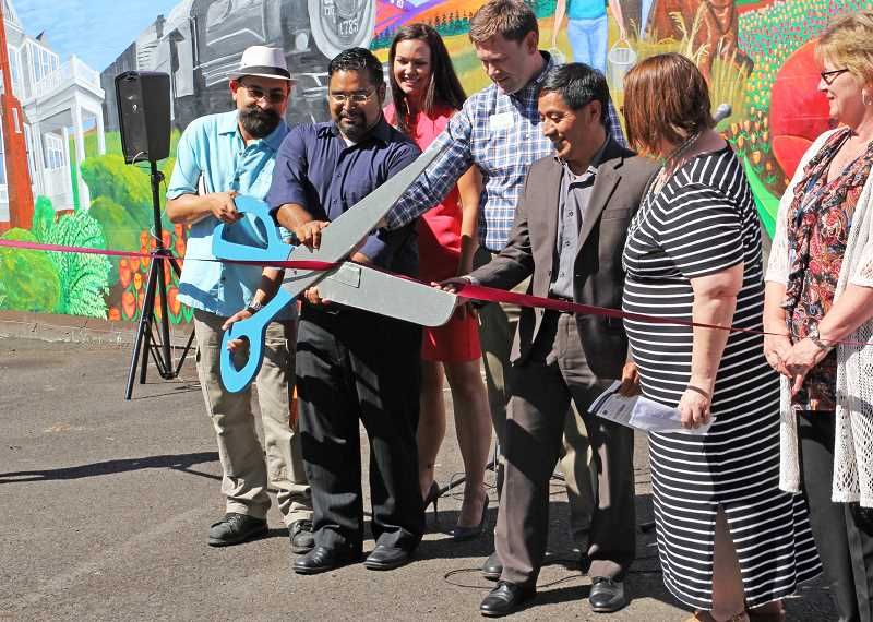 INDEPENDENT FILE PHOTO - The ribbon cutting for the mural on the Woodburn Independent's wall was in late July.
