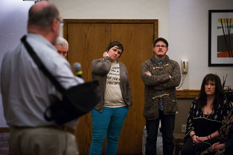 TRIBUNE PHOTO: ADAM WICKHAM - FamilyCare CEO Jeff Heathering, his back to the camera, addresses a group of providers during a dramatic meeting in which they convinced him to support a one-month extension of the nonprofit's operations for Oregon Health Plan members.