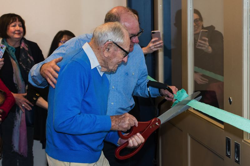COURTESY - In this November photo, 96-year-old Don Moore helps cut the ribbon for the Jane Moore Community Room attached to the Banks Public Library.