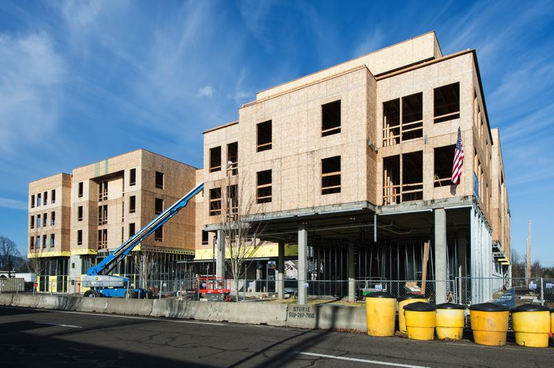 NEWS-TIMES FILE PHOTO: CHRISTOPHER OERTELL - The Jesse Quinn apartment complex in downtown Forest Grove, pictured here in December, has taken shape over the course of the year.