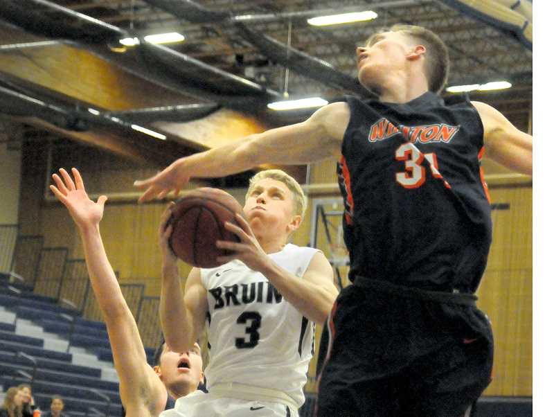 GARY ALLEN - Freshman guard Jackson Januik drives to the basket during the Bruin's 86-81 loss to Wheaton College Thursday at Wheeler Sports Center.