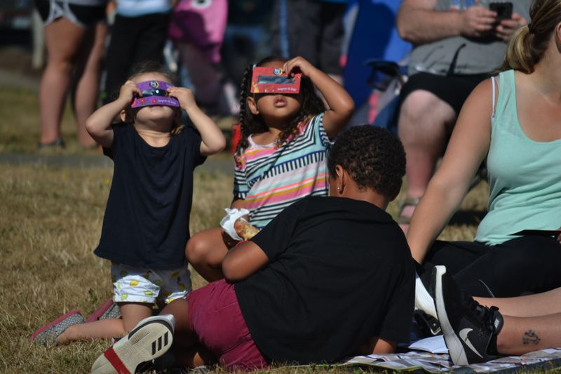 POST PHOTO: BRITTANY ALLEN - On Aug. 21, several community members and city staff came together to watch the 99 percent total eclipse at Sandy Bluff Park.