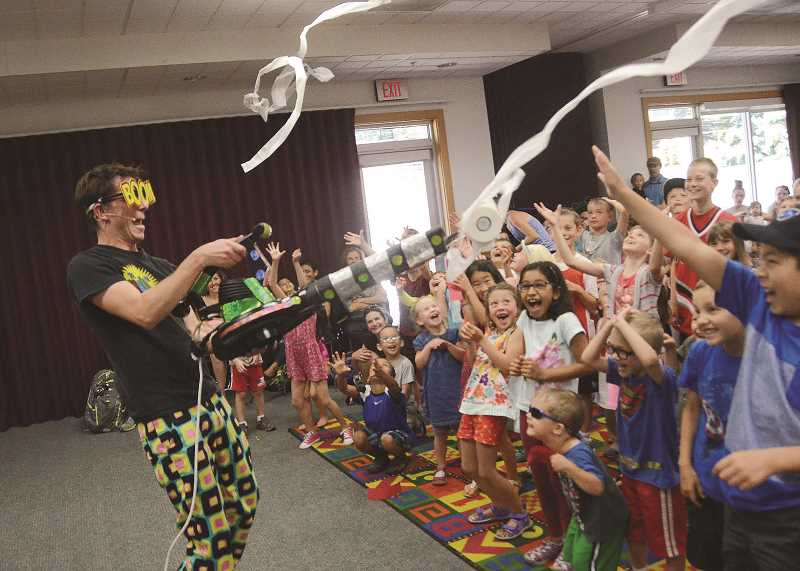 SPOKESMAN FILE PHOTO - Zerby, a self-described zaniac, delights the crowd at the Wilsonville Library this finishing act in a performance this June